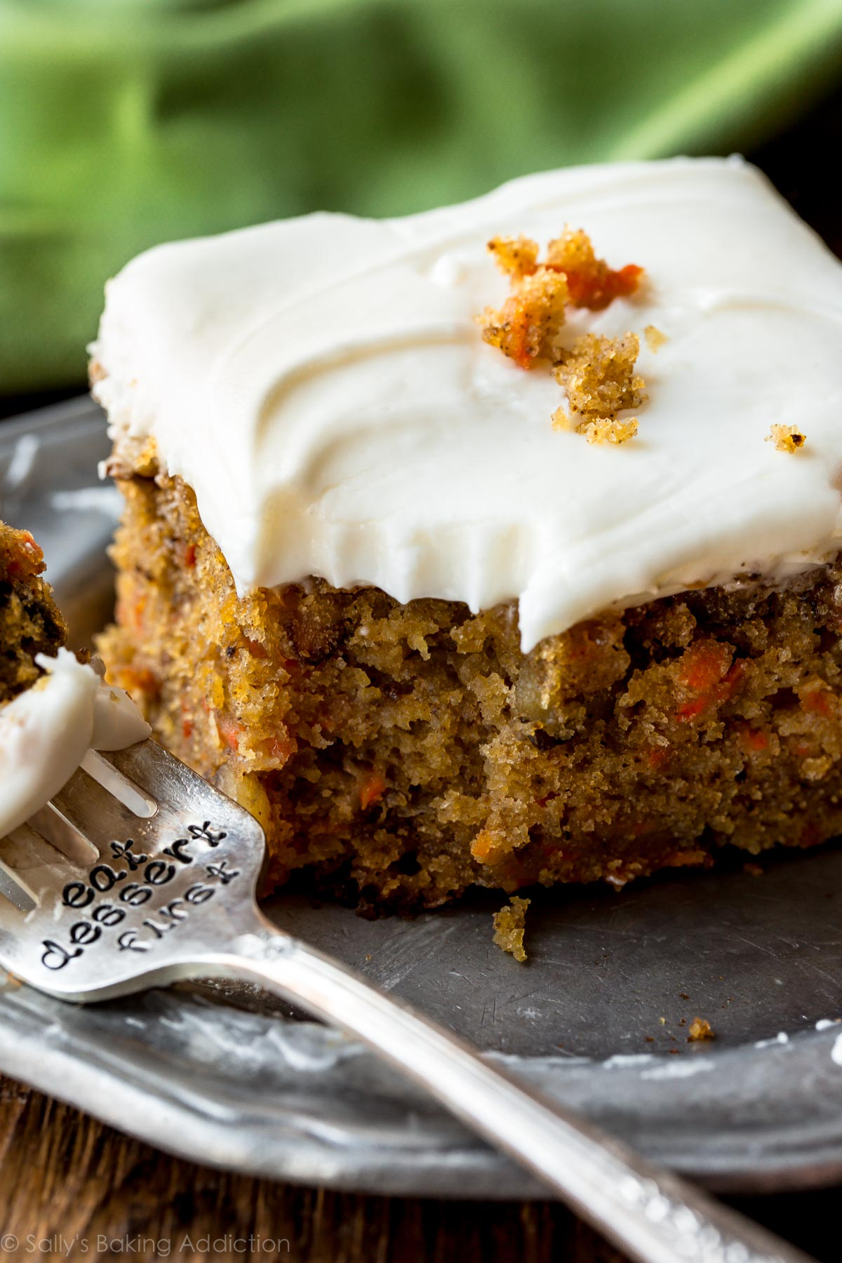 The best carrot cake recipe is this pineapple carrot cake with cream cheese frosting! Moist, spiced, and so easy! Dessert on sallysbakingaddiction.com