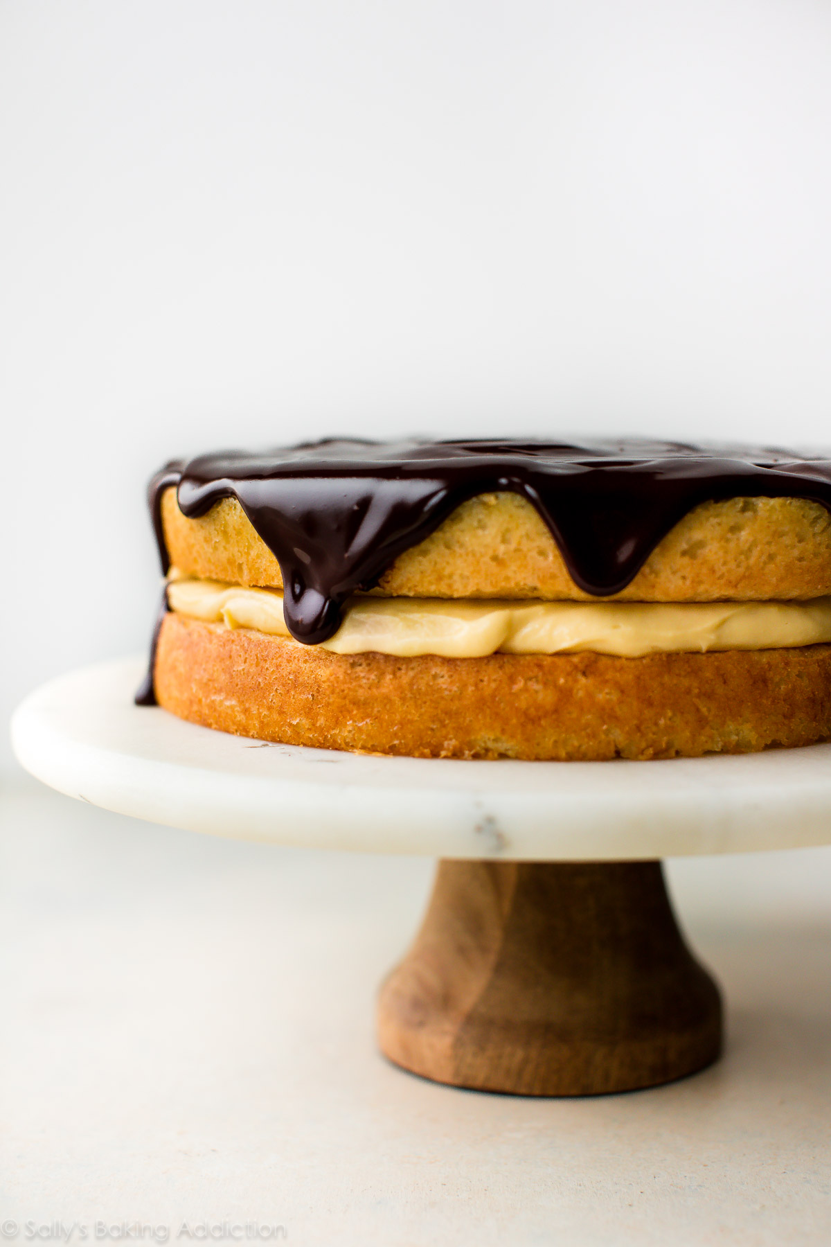 Completely from-scratch with homemade pastry cream, buttery sponge cake, and shiny chocolate glaze, this classic Boston cream pie recipe is supremely decadent and satisfying. Recipe on sallysbakingaddiction.com